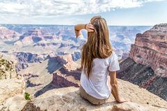 Teen girl looks out over the vast canyon Stock Photography