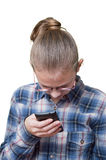 Teen girl looks into the phone. Or dials a number Royalty Free Stock Image