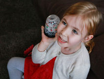 Teen girl looks up with snow globe in hand Royalty Free Stock Photography