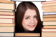 Teen girl with lot of books around Royalty Free Stock Photos