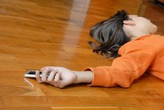 Teen girl lying on floor Stock Images