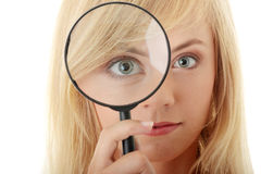 Teen girl with magnifier Royalty Free Stock Photography