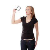 Teen girl with magnifier Royalty Free Stock Images