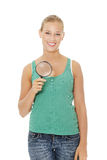 Teen girl with magnifier . Stock Images