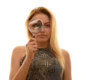 Teen girl with magnifying glass Stock Photography