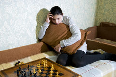 Teen girl making checkmate playing chess. She is winner stock photo