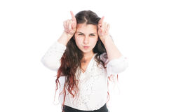 Teen girl making evil horns with fingers Stock Image