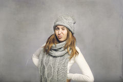 Teen girl making faces. Young girl on grey background acting cute Royalty Free Stock Photography