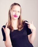 Teen girl making funny faces Stock Photos