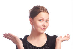 Teen girl making funny faces on white background Royalty Free Stock Images