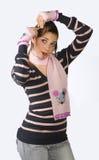 Teen girl making hair Stock Image
