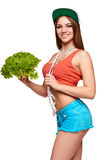 Teen girl with measurement tape holding lettuce Stock Photography