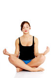 Teen girl meditating. On white background Royalty Free Stock Photos