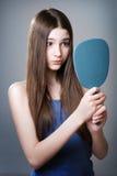 Teen girl with a mirror. Teen girl unhappy with their appearance Stock Photos