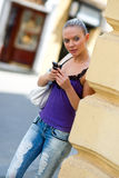 Teen girl with mobile phone Stock Images