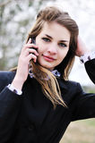 Teen girl with mobile phone Royalty Free Stock Images