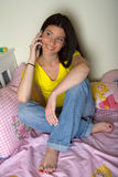 Teen girl with mobile phone. Smiling teen girl with mobile phone Royalty Free Stock Images