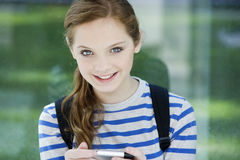 Teen girl with mobile phone Royalty Free Stock Image