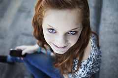 Teen girl with mobile phone Stock Photography