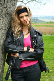 Teen girl in motorbike clothing. Teen girl dressed in motorbike clothing stock photos