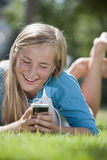 Teen girl with MP3 player Royalty Free Stock Images