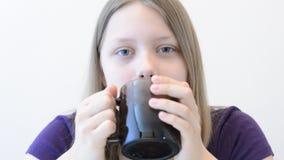 Teen girl with mug Royalty Free Stock Images