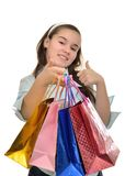 Teen girl with multicolored packages in hands rejoices purchases Stock Images