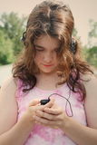 Teen girl music mp3 Royalty Free Stock Photos