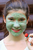 Teen girl with natural blue clay face mask Royalty Free Stock Photo