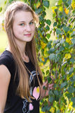 Teen girl near a birch Stock Images