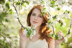 Teen girl near blossom tree Stock Images