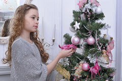 Teen girl near the Christmas tree Stock Photos