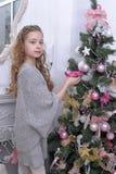 Teen girl near the Christmas tree Stock Images
