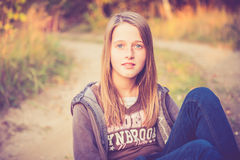 Teen girl near road Stock Photo