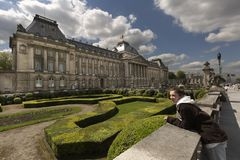 Teen girl next to the royal palace with its gardens in Brussels capital of Belgium. Royalty Free Stock Images