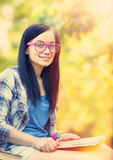 Teen girl with notebook Royalty Free Stock Photo