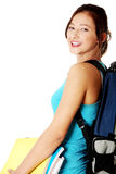 Teen girl with notes and backpack smiling. Stock Photos