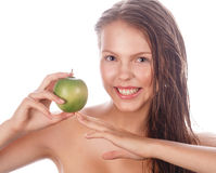 Teen girl with nude makeup holding green apple. Stock Photography