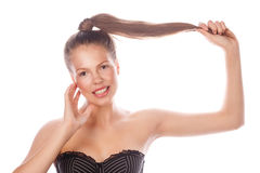 Teen Girl with nude makeup is holding her hair. Royalty Free Stock Photography