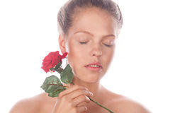 Teen Girl with nude makeup holds rose flower. Royalty Free Stock Photos