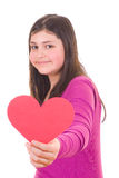 Teen girl offering a valentine Stock Images