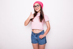 Teen girl with okey gesture. On white Royalty Free Stock Photography