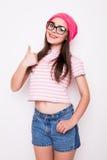 Teen girl with okey gesture Stock Photos