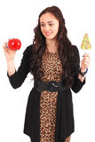 Teen girl with one lollipop and one apple Royalty Free Stock Photo