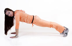 Teen Girl In Orange Sweats Doing Push-up Royalty Free Stock Photo
