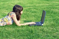 Teen girl in outdoor study. With a laptop Royalty Free Stock Image