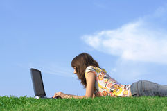 Teen girl in outdoor study. With a laptop Stock Photography