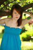 Teen girl outside by tree Stock Photos