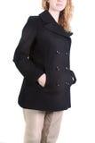 Teen girl in overcoat Stock Photos