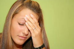 Teen girl in pain. Teenager girl with headache and she holding her head with hand Royalty Free Stock Photography